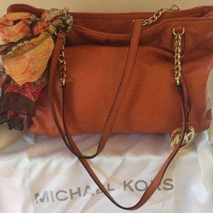 Michael Kors orange handbag with cute scarf